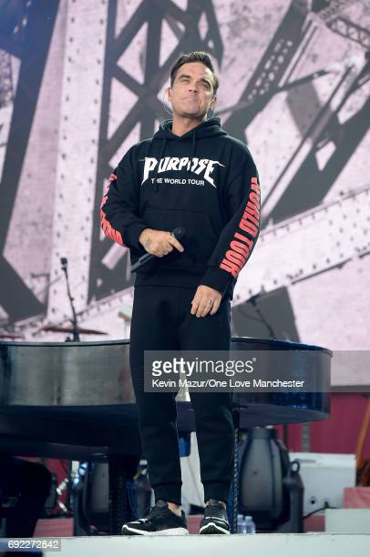 Robbie Williams performs on stage during the One Love Manchester Benefit Concert at Old Trafford Cricket Ground on June 4 2017 in Manchester England