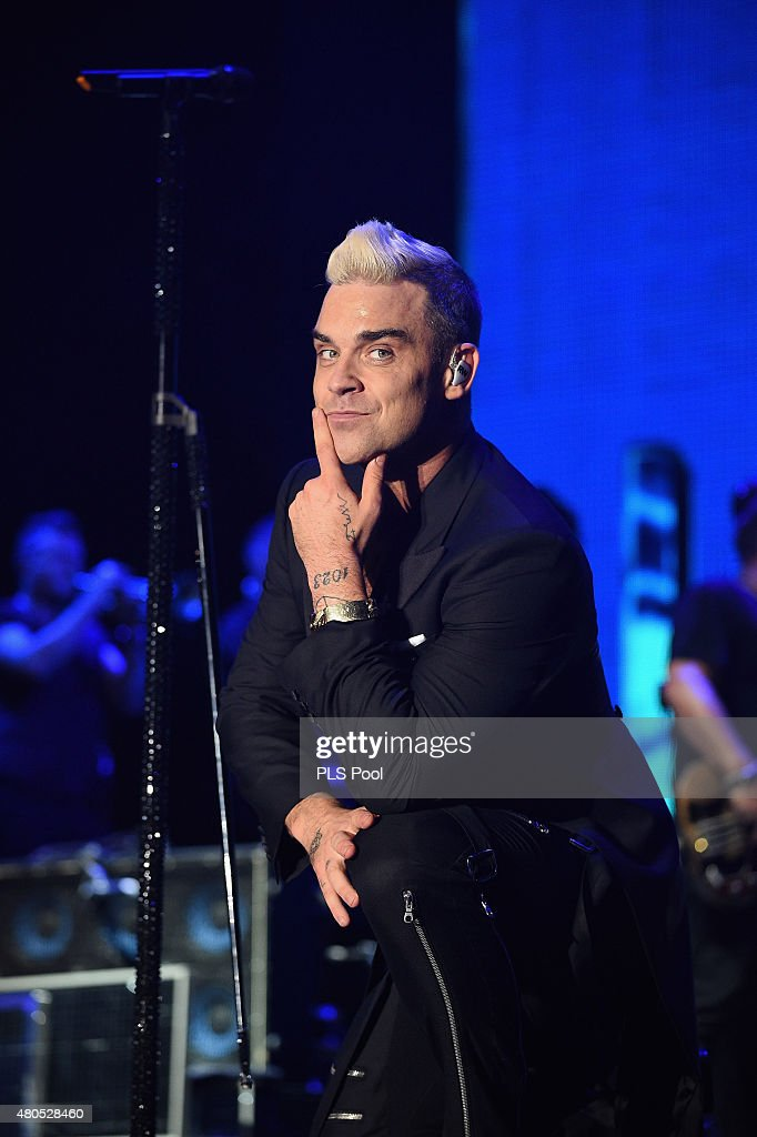 Robbie Williams performs onstage during the Second Day of the 10th Anniversary on the Throne Celebrations on July 12 2015 in Monaco Monaco