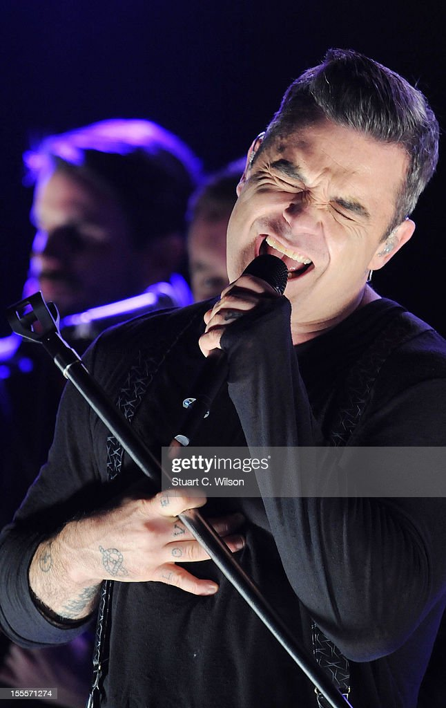 Robbie Williams performs prior to the Oxford Street Christmas Lights switching on on November 5, 2012 in London, England.