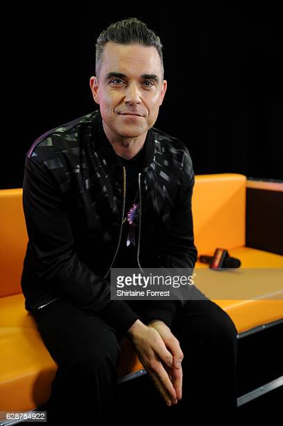 Robbie Williams poses backstage at Key 103 Christmas Live at Manchester Arena on December 9 2016 in Manchester England