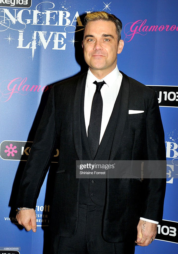 Robbie Williams poses backstage at the Key 103 Jingle Bell Ball at Phones 4U Arena on December 12 2013 in Manchester England