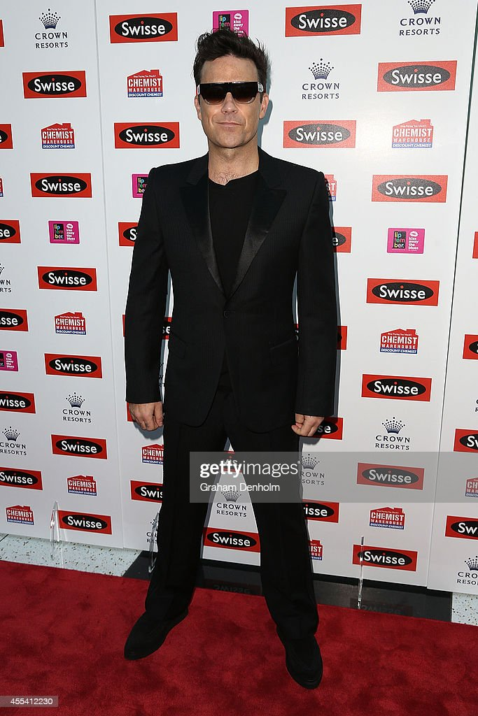 Robbie Williams poses on the red carpet prior to his performance at the Palms at Crown on September 14 2014 in Melbourne Australia