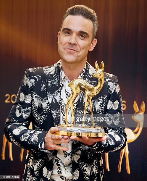 Robbie Williams poses with award at the Bambi Awards 2016 winners board at Stage Theater on November 17 2016 in Berlin Germany