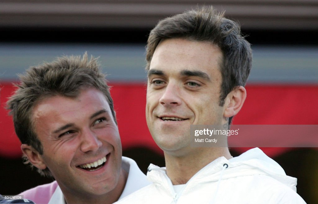 Robbie Williams (R) shares a joke with his friend and presenter Jonathan Wilkes at the end of the first day of The All-Star Cup Celebrity Golf tournament at the Celtic Manor Resort on August 28, 2005 Newport, Wales. The cup is the brainchild of Anthony McPartlin and Declan Donnelly, and it sees 2 teams of 10 celebrities from Europe and the US taking part over the Roman Road course, venue of the 2010 Ryder Cup, with Colin Montgomerie and Mark O?Meara as the non-playing captains of the European and US teams respectively. The cup will be presented by Kirsty Gallacher and Jamie Theakston.