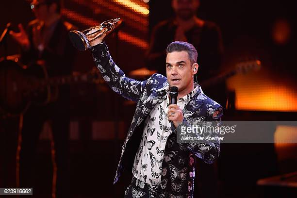Robbie Williams speaks on stage during the Bambi Awards 2016 show after receiving the award for best Musician International at Stage Theater on...