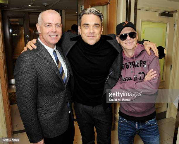 Robbie Williams winner of the Q Idol award poses with Pet Shop Boys Neil Tennant and Chris Lowe in the press room at The Q Awards at The Grosvenor...