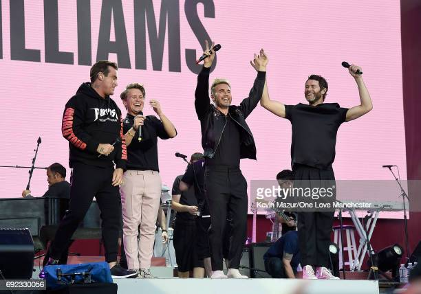 Robbie Williams with Howard Donald Gary Barlow and Mark Owen of Take That on stage during the One Love Manchester Benefit Concert at Old Trafford...