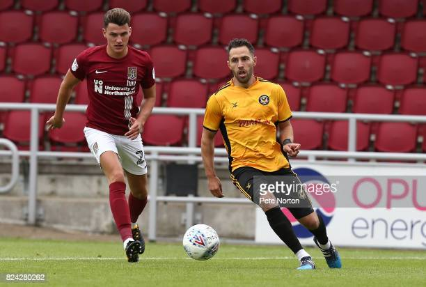 Robbie Willmott of Newport County looks to the ball with Regan Poole of Northampton Town during the PreSeason Friendly match between Northampton Town...