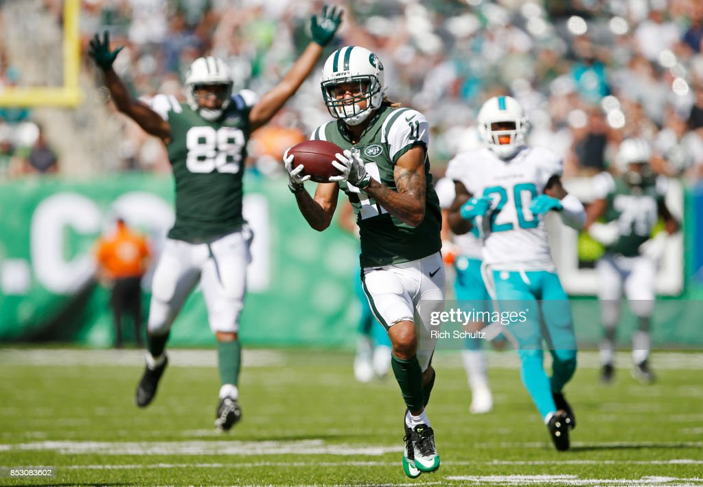 Robby Anderson #11 of the New York Jets catches a touchdown pass against the Miami Dolphins during the first half of an NFL game at MetLife Stadium on September 24, 2017 in East Rutherford, New Jersey.