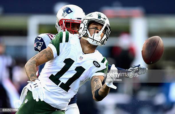 Robby Anderson of the New York Jets drops a pass during the second half of a game against the New England Patriots at Gillette Stadium on December 24...