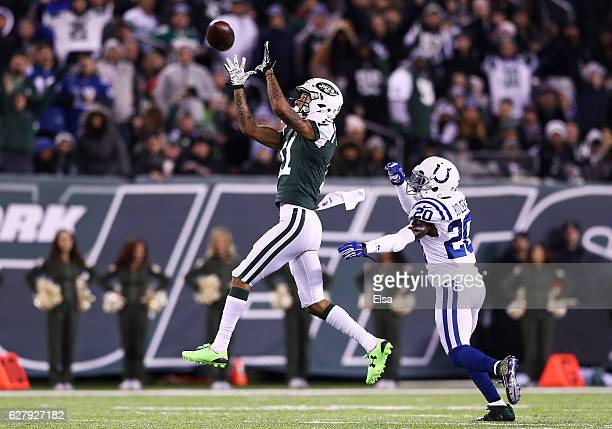 Robby Anderson of the New York Jets fails to complete a pass as Darius Butler of the Indianapolis Colts defends in the third quarter during their...