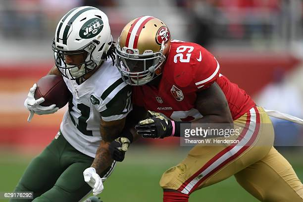 Robby Anderson of the New York Jets is hit by Jaquiski Tartt of the San Francisco 49ers during their NFL game at Levi's Stadium on December 11 2016...