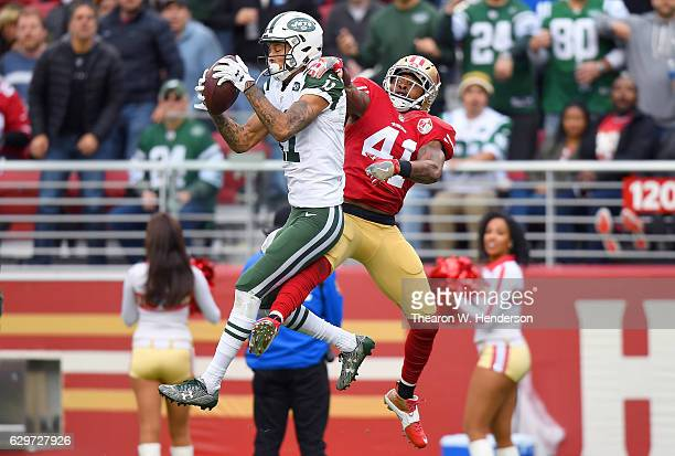 Robby Anderson of the New York Jets leaps to catch a pass in front of Antoine Bethea of the San Francisco 49ers during the third quarter of their NFL...