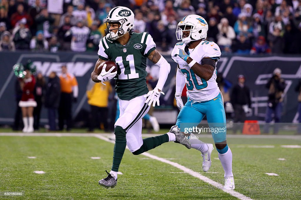 Robby Anderson #11 of the New York Jets runs a 40 yard touchdown pass against Bacarri Rambo #30 of the Miami Dolphins during the first quarter of the game at MetLife Stadium on December 17, 2016 in East Rutherford, New Jersey.