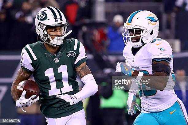 Robby Anderson of the New York Jets runs a 40 yard touchdown pass against Bacarri Rambo of the Miami Dolphins during the first quarter of the game at...