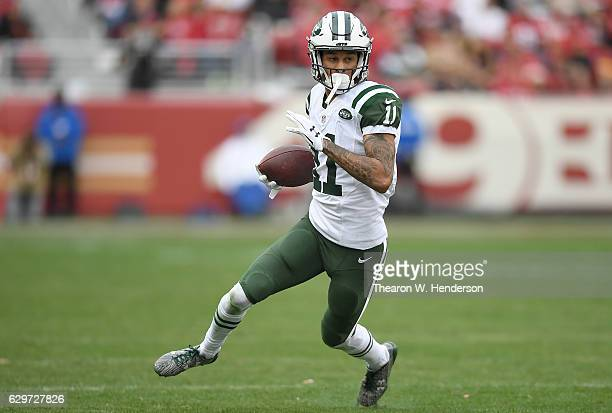 Robby Anderson of the New York Jets runs with the ball after catching a pass against the San Francisco 49ers during the second quarter of their NFL...