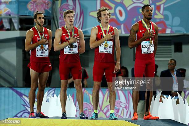 Robby Andrews Casimir Loxsom Erik Sowinski and Duane Solomon of the United States stand on the podium after winning the final of the men's 4 x 800...