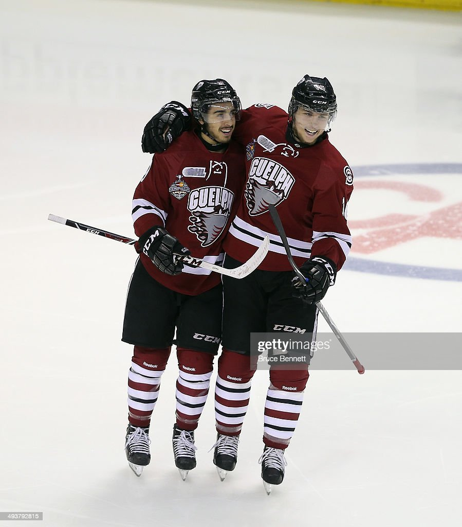Robby Fabbri #9 (L) of the Guelph Storm celebrates with Kerby Rychel #16 (R) at 1:00 of the first period after scoring against the Edmonton Oil Kings during the 2014 Memorial Cup championship game at Budweiser Gardens on May 25, 2014 in London, Ontario, Canada.