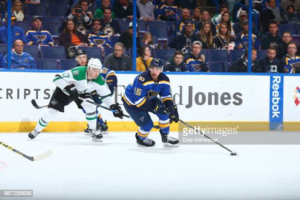 Robby Fabbri of the St Louis Blues handles the puck against Devin Shore of the Dallas Stars at the Scottrade Center on November 28 2016 in St Louis...