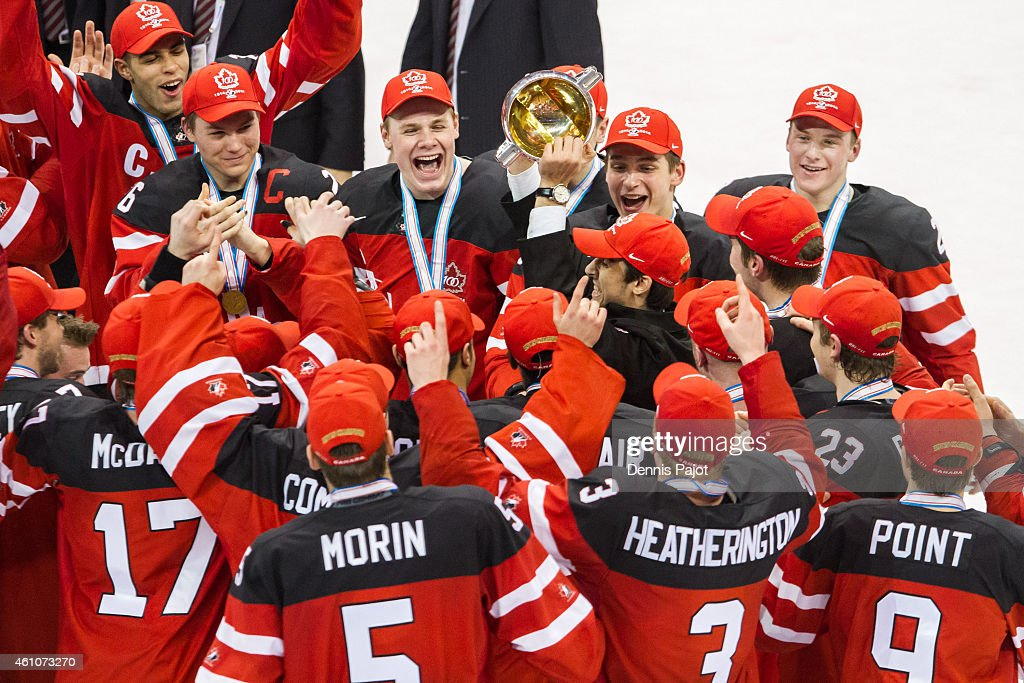 Robby Fabri of Canada hoists the cup after a 54 win over Russia during the Gold medal game of the 2015 IIHF World Junior Championship on January 05...