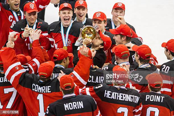 Robby Fabri of Canada kisses the cup after a 54 win over Russia during the Gold medal game of the 2015 IIHF World Junior Championship on January 05...