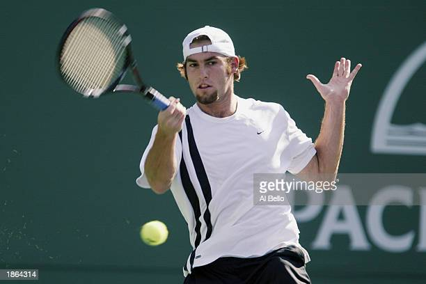 Robby Ginepri of the USA returns to Marat Safin of Russia during the Pacific Life Open on March 13 2003 at the Indian Wells Tennis Garden in Indian...