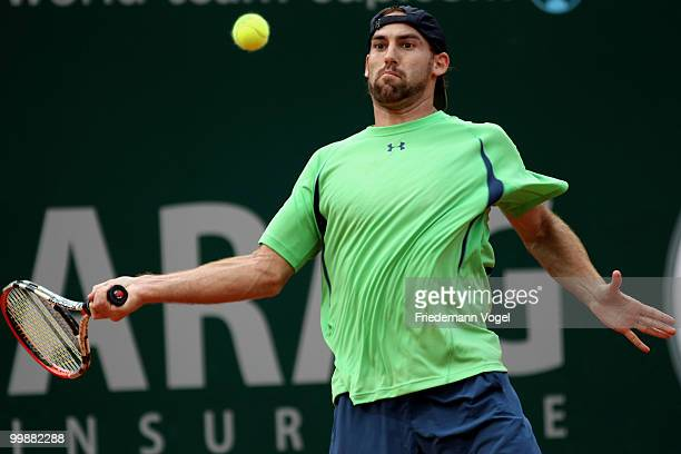 Robby Ginepri of USA plays a backhand during his match against Nicolas Almagro of Spain during day three of the ARAG World Team Cup at the Rochusclub...