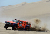 Robby Gordon and copilot Kellon Walch of team Hummer compete in the special stage during day one of the of the 2013 Dakar Rally on January 5 2013 in...