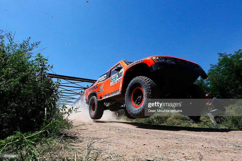 <a gi-track='captionPersonalityLinkClicked' href=/galleries/search?phrase=Robby+Gordon&family=editorial&specificpeople=165241 ng-click='$event.stopPropagation()'>Robby Gordon</a> and Johnny Campbell of the USA driving for Speed Energy Racing HST Hummer compete during day 1 of the Dakar Rallly on January 4, 2015 between Buenos Aires and Villa Carlos Paz, Argentina.