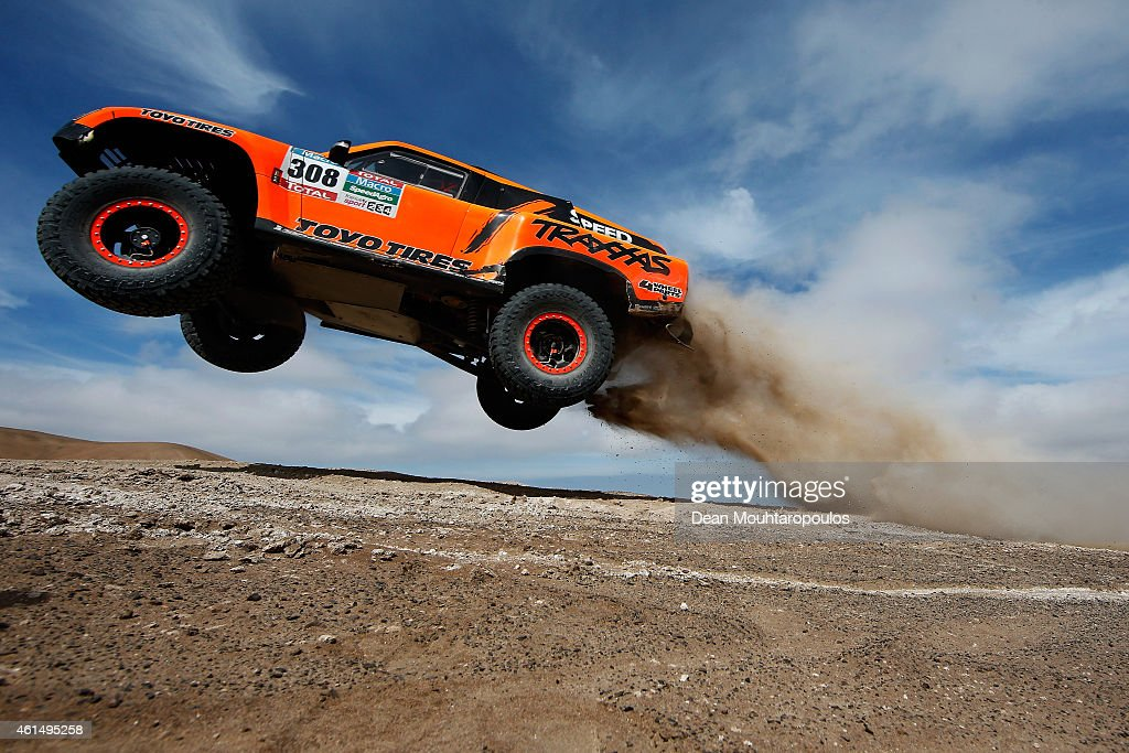 Robby Gordon and Johnny Campbell of the USA driving for Speed Energy Racing HST Hummer launches over a jump in the Atacama Desert during day 10 of...