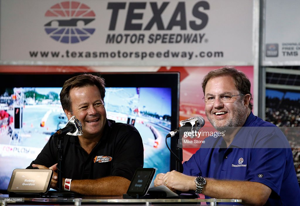 Robby Gordon and TMS President Eddie Gossage laugh during a media conference regarding regarding the SPEED Energy Stadium SUPER Trucks being added to the TMS schedule before the Verizon IndyCar Series Firestone 600 at Texas Motor Speedway on August 27, 2016 in Fort Worth, Texas.