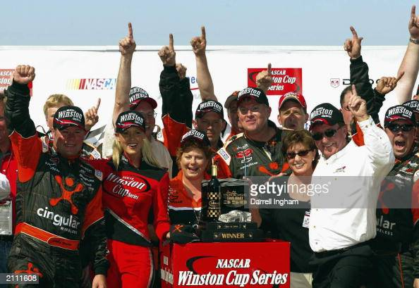 Robby Gordon driver of the Cingular Wireless Chevrolet and team owner Richard Childress celebrate winning the NASCAR Winston Cup Dodge Save Mart 350...
