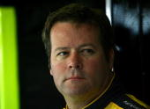 Robby Gordon driver of the MAPEI/Menards Toyota stands in the garage during practice for the NASCAR Sprint Cup Series Dickies 500 at Texas Motor...