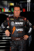 Robby Gordon driver of the Mapei/Menards/Speed Energy Dodge stands in the garage during practice for the NASCAR Sprint Cup Series Daytona 500 at...