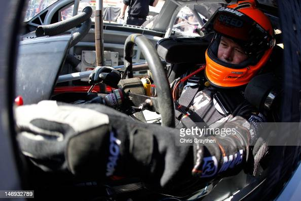 Robby Gordon driver of the MAPEI/Save Mart Supermarkets Dodge sits in his car during practice for the NASCAR Sprint Cup Series Toyota/Save Mart 350...