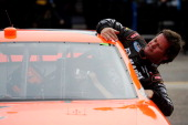 Robby Gordon driver of the Speed Energy Dodge climbs out of his car during practice for the NASCAR Sprint Cup Series Kobalt Tools 500 at Phoenix...