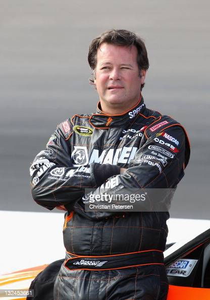 Robby Gordon driver of the Speed Energy Dodge looks on during qualifying for the NASCAR Sprint Cup Series Kobalt Tools 500 at Phoenix International...