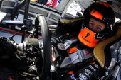 Robby Gordon driver of the Speed Energy Dodge sits in his car during practice for the NASCAR Sprint Cup Series Jeff Byrd 500 Presented By Food City...