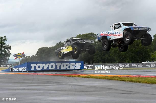 Robby Gordon leads Jeff Hoffman1 over a jump during the SPEED Energy Stadium Super Trucks Race at Watkins Glen International on September 3 2017 in...