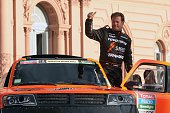 Robby Gordon of the US waves from his Hummer during the symbolic start of the 2015 Dakar Rally in Buenos Aires on January 3 2015 The race across...