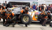 Robby Gordon's crew races to change tires against the clock during the Union 76 / Rockingham World Pit Crew Competition at North Carolina Speedway...