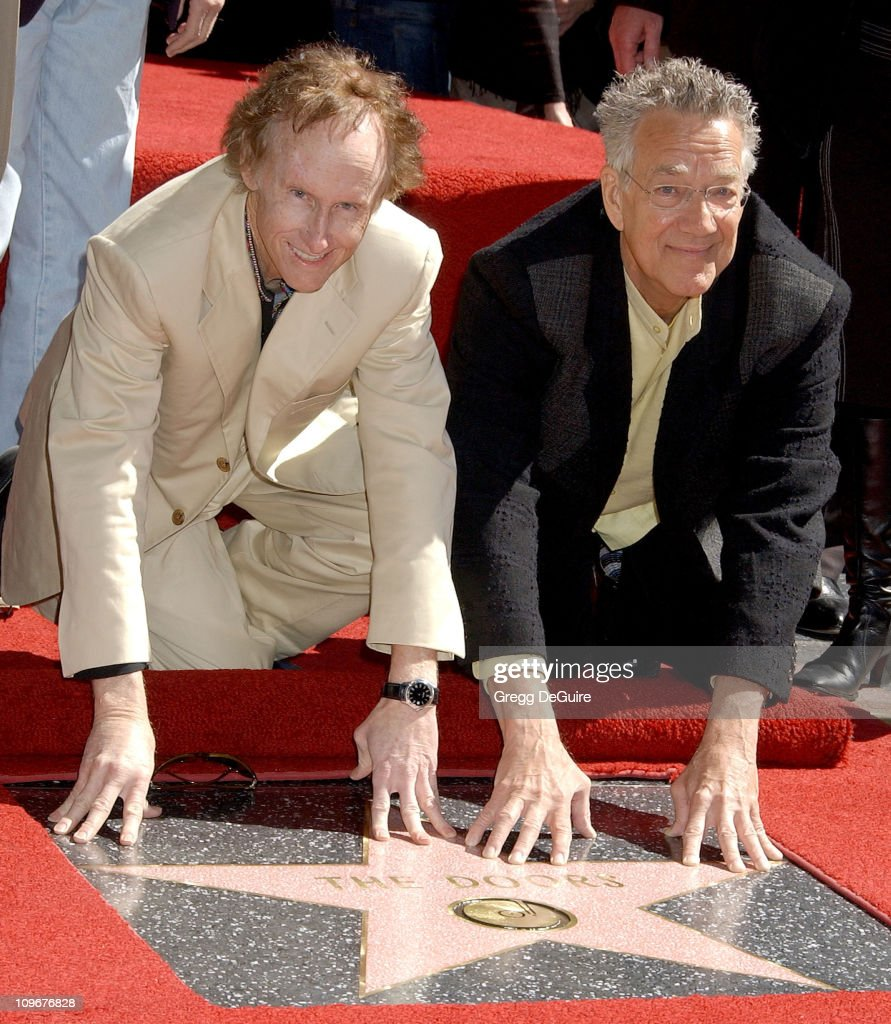 <a gi-track='captionPersonalityLinkClicked' href=/galleries/search?phrase=Robby+Krieger&family=editorial&specificpeople=1846343 ng-click='$event.stopPropagation()'>Robby Krieger</a> and <a gi-track='captionPersonalityLinkClicked' href=/galleries/search?phrase=Ray+Manzarek&family=editorial&specificpeople=926931 ng-click='$event.stopPropagation()'>Ray Manzarek</a> of <a gi-track='captionPersonalityLinkClicked' href=/galleries/search?phrase=The+Doors+-+Band&family=editorial&specificpeople=926928 ng-click='$event.stopPropagation()'>The Doors</a> during <a gi-track='captionPersonalityLinkClicked' href=/galleries/search?phrase=The+Doors+-+Band&family=editorial&specificpeople=926928 ng-click='$event.stopPropagation()'>The Doors</a> Celebrate 40th Anniversary with a Star on the Hollywood Walk of Fame at Hollywood Blvd. in Hollywood, California, United States.