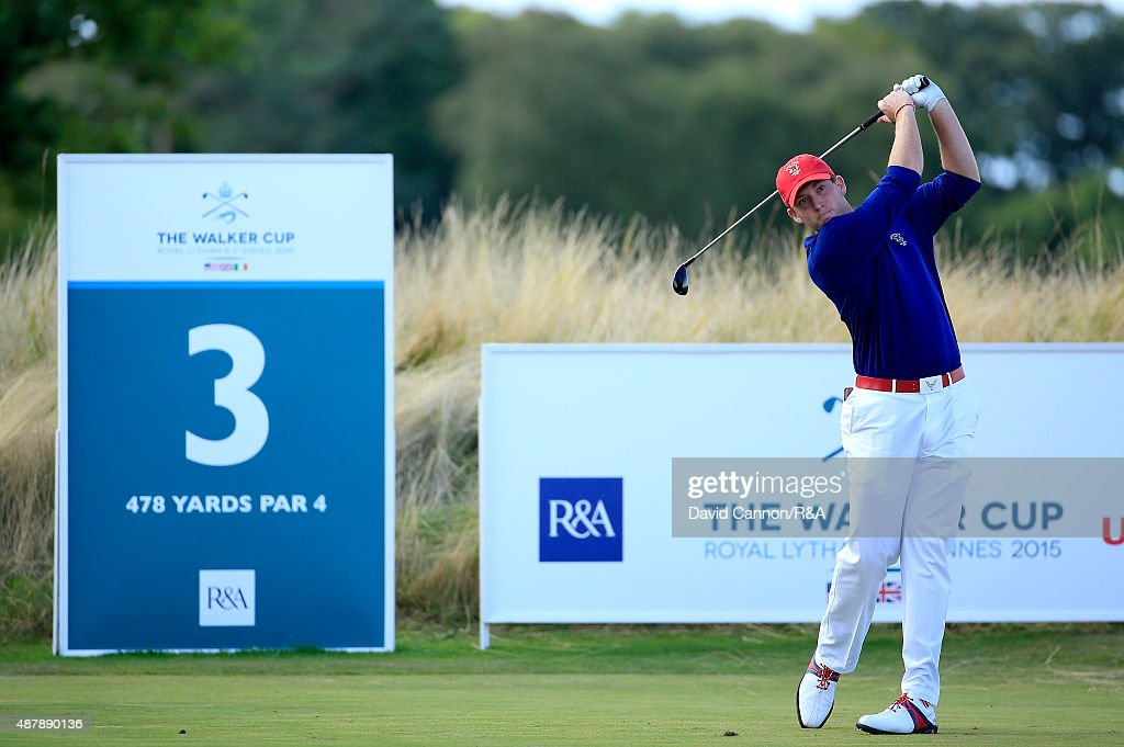Robby Shelton of the United States team plays his tee shot on the third hole against Gary Hurley of the Great Britain and Ireland Team during the...