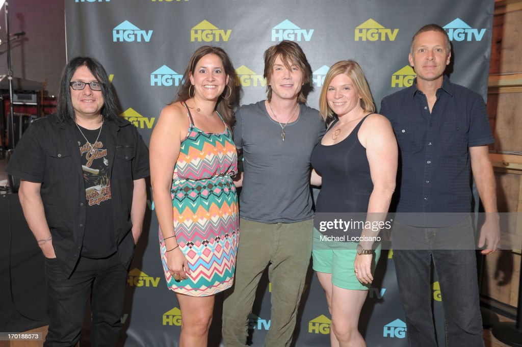 Robby Takac, John Rzeznik and Mike Malinin of the Goo Goo Dolls pose with fans during HGTV'S The Lodge At CMA Music Fest - Day 3 on June 8, 2013 in Nashville, Tennessee.