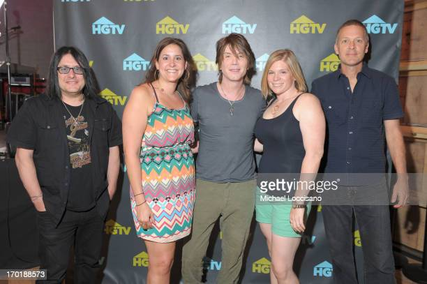 Robby Takac John Rzeznik and Mike Malinin of the Goo Goo Dolls pose with fans during HGTV'S The Lodge At CMA Music Fest Day 3 on June 8 2013 in...