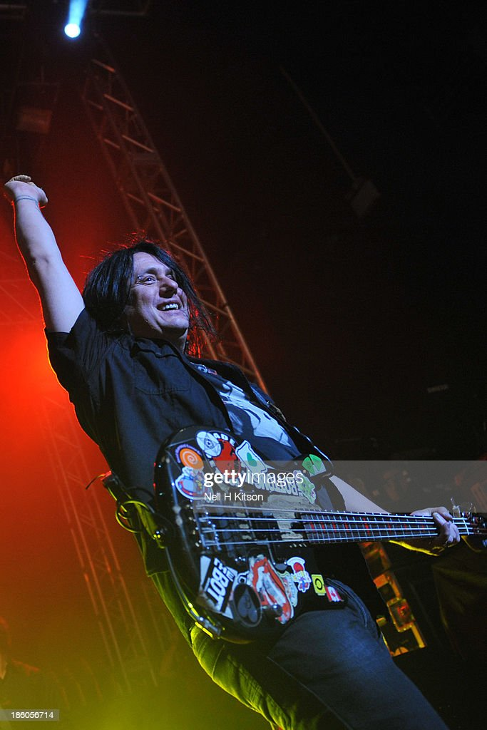 <a gi-track='captionPersonalityLinkClicked' href=/galleries/search?phrase=Robby+Takac&family=editorial&specificpeople=778886 ng-click='$event.stopPropagation()'>Robby Takac</a> of Goo Goo Dolls performs at 02 academy on October 20, 2013 in Leeds, England.