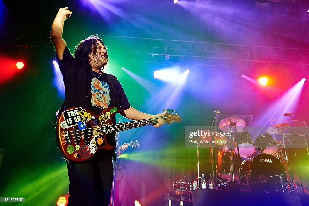 <a gi-track='captionPersonalityLinkClicked' href=/galleries/search?phrase=Robby+Takac&family=editorial&specificpeople=778886 ng-click='$event.stopPropagation()'>Robby Takac</a> of Goo Goo Dolls performs on stage at Manchester Academy on October 16, 2013 in Manchester, England.