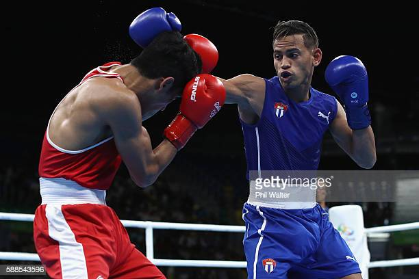 Robeisy Ramirez of Cuba fights Shiva Thapa of India in their Mens Bantamweight bout on Day 6 of the 2016 Rio Olympics at Riocentro Pavilion 6 on...