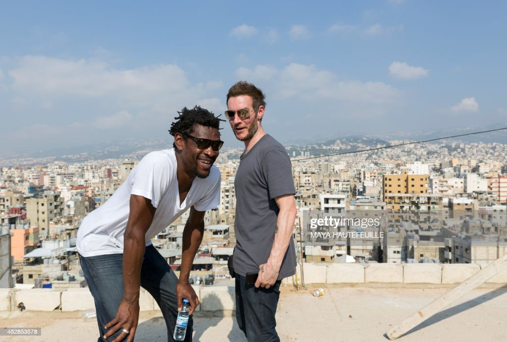 Robert '3D' del Naja and Grantley 'Daddy G' Marshall of British triphop band Massive Attack pose for a picture during an unofficial visit to the Burj...