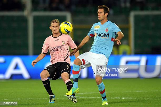Robert Acquafresca of Bologna controls the ball as Mauro Cetto of Palermo tackles during the Serie A match between US Citta di Palermo and Bologna FC...